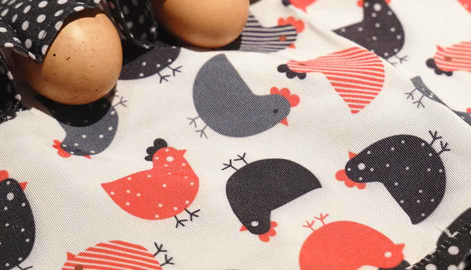 detail shot of apron fabric with colourful print
